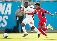 CHARLOTTE, NC - JUNE 23: Junior Hoilett #10 makes a run with Daniel Morejon #5 defending during a game between Cuba and Canada at Bank of America Stadium on June 23, 2019 in Charlotte, North Carolina.