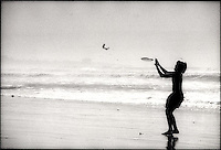 Playing frisbee on the beach<br />