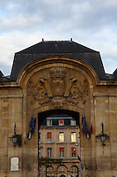 The Bicêtre Hospital, in the municipality of Kremlin- Bicêtre near Paris, has a long history: it was a monastery, a castle, an hospital and a prison. This is the central part of the ancient main entrance in foreground, under a beautiful typically Parisian sky, in the sunrise light.