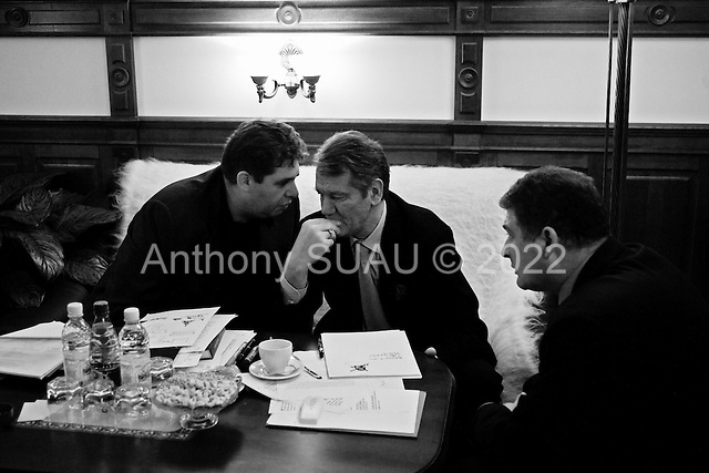 """Kiev, Ukraine.December 29, 2004..Just hours before being officially declared president of the Ukraine Victor Yushschenko meets privately with associates in his office.  ..The first round of voting was considered fraudulent when the ruling president Viktor Yahukovich won and the opposition candidate Viktor Yushchenko lost. ..Several hundred thousand Ukrainians took to the streets of Kiev and held daily rallies on Maidan Independence Square. The protests lasted nearly a month before the first vote was declared invalid and a new round of elections held on December 26, 2004. ..The demonstrations would come to be known as the """"Orange Revolution"""" after the color of the opposition party."""