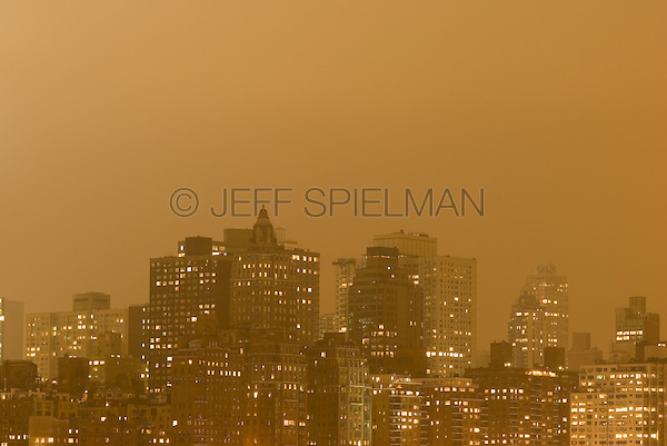 AVAILABLE FROM JEFF AS A FINE ART PRINT.<br /> <br /> AVAILABLE FROM PLAINPICTURE FOR COMMERCIAL AND EDITORIAL LICENSING.  Please go to www.plainpicture.com and search for image # p5690081.<br /> <br /> Illuminated Skyline of Manhattan's Upper East Side on an Overcast Night, New York, New York, USA