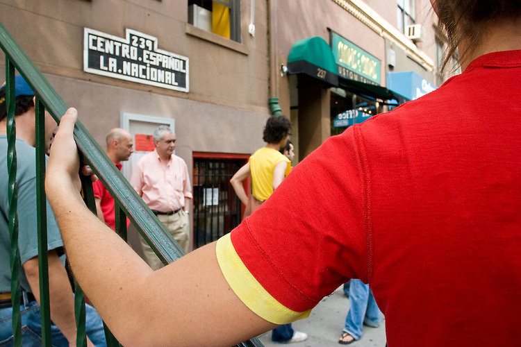 Spain fans during halftime of their team's match against Tunisia on June 19, 2006 at La Nacional, a restaurant in New York City.<br /> <br /> The World Cup, held every four years in different locales, is the world's pre-eminent sports tournament in the world's most popular sport, soccer (or football, as most of the world calls it).  Qualification for the World Cup is open to any country with a national team accredited by FIFA, world soccer's governing body. The first World Cup, organized by FIFA in response to the popularity of the first Olympic Games' soccer tournaments, was held in 1930 in Uruguay and was participated in by 13 nations.    <br /> <br /> As of 2010 there are 208 such teams.  The final field of the World Cup is narrowed down to 32 national teams in the three years preceding the tournament, with each region of the world allotted a specific number of spots.  <br /> <br /> The World Cup is the most widely regularly watched event in the world, with soccer teams being a source of national pride.  In most nations, the whole country is at a standstill when their team is playing in the tournament, everyone's eyes glued to their televisions or their ears to the radio, to see if their team will prevail.  While the United States in general is a conspicuous exception to the grip of World Cup fever there is one city that is a rather large exception to that rule.  In New York City, the most diverse city in a nation of immigrants, the melting pot that is America is on full display as fans of all nations gather in all possible venues to watch their teams and celebrate where they have come from.
