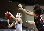 SIOUX FALLS, SD - MARCH 6: Tylee Irwin #21 of the South Dakota State Jackrabbits shoots past Mariah Murdie #33 of the Omaha Mavericks during the Summit League Basketball Tournament at the Sanford Pentagon in Sioux Falls, SD. (Photo by Richard Carlson/Inertia)