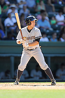 Second baseman Vicente Conde (4) of the Charleston RiverDogs bats in a game against the Greenville Drive on Sunday, June 28, 2015, at Fluor Field at the West End in Greenville, South Carolina. Charleston won, 12-9. (Tom Priddy/Four Seam Images)