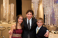 B'nai Mitzvah twins posing with their older brother.
