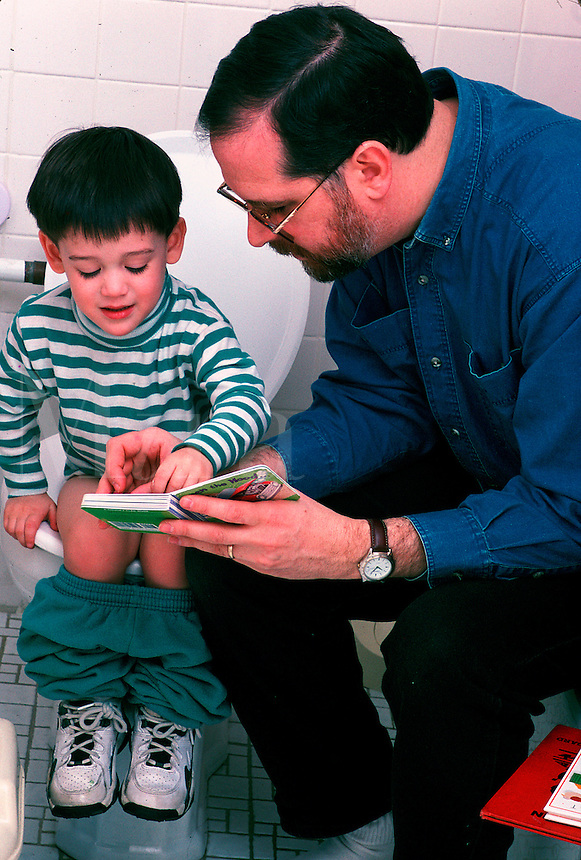 Father with young son toilet training.