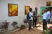 Visitor Arriving to View the Work of Artist Abdoukarim Fall, from Saint Louis, at Biannual Arts Festival, Goree Island, Senegal.
