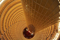 Looking down through the center core of the Jinmao Tower to the lobby below.<br /> <br /> To license this image, please contact the National Geographic Creative Collection:<br /> <br /> Image ID: 2169234 <br />  <br /> Email: natgeocreative@ngs.org<br /> <br /> Telephone: 202 857 7537 / Toll Free 800 434 2244<br /> <br /> National Geographic Creative<br /> 1145 17th St NW, Washington DC 20036