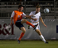 Vince Cicciarelli (21) of Notre Dame fights for the ball with Kevin McBride (15) of Virginia during the ACC tournament semifinals at the Maryland SoccerPlex in Boyds, MD.  Virginia advanced to the finals after tying Notre Dame, 3-3, in overtime and then defeating them on penalty kicks.