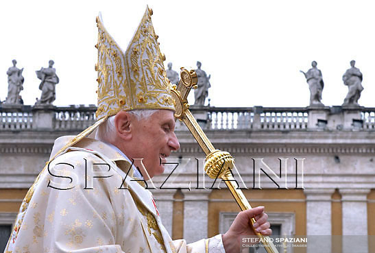 Pope Benedict XVI holds a woven palm frond while celebrating an open-air  Easter mass in St. Peter's square at the Vatican Sunday, April 12, 2009.