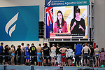 Swimmers and Coaches watch as Prime Minister Ardern takes NZ into Level 4 lockdown after a community case was discovered in Auckland. Apollo Projects NZ Short Course Championships, Millennium Institute, Auckland, New Zealand. Tuesday 17 August 2021 Photo: Simon Watts/www.bwmedia.co.nz