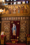 Cairo, Egypt -- The Hanging Church (El Muallaqa) of St. Mary, is the most famous of Cairo's Christian churches.  It was built atop the sourther tower gate of the old Babylonian fortress in what is now Coptic Cairo and overhangs the original gate passage.  The interior of the church shows the unmistakable ornate decoration found in Coptic (Orthodox) churches. © Rick Collier / RickCollier.com
