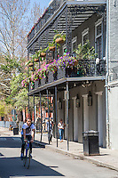 French Quarter, New Orleans, Louisiana.  Balcony with Petunias and Hanging Flower Baskets.