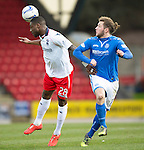 St Johnstone v Ross County...15.03.14    SPFL<br /> Yann Songo'o and Stevie May<br /> Picture by Graeme Hart.<br /> Copyright Perthshire Picture Agency<br /> Tel: 01738 623350  Mobile: 07990 594431