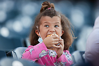A young fan enjoys a hot dog during the minor league baseball game between the Hickory Crawdads and the Greensboro Grasshoppers at First National Bank Field on May 6, 2021 in Greensboro, North Carolina. (Brian Westerholt/Four Seam Images)