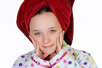 Silly Girl with towel on head wearing pajamas.