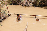 Israel, Galilee, Jordan River,where Jesus came from Nazareth  was baptized by John, pilgrims take a bath in the holy water