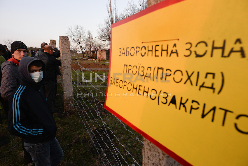 Pro-russian citizens of Kramatorsk in front of the airport taken by Ukrainian soldiers during anti-terrorist operation