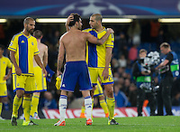 Cesc Fabregas of Chelsea with Tal Ben Haim I(former Chelsea player) of Maccabi Tel Aviv at the final whistle during the UEFA Champions League match between Chelsea and Maccabi Tel Aviv at Stamford Bridge, London, England on 16 September 2015. Photo by Andy Rowland.