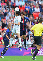 August 07, 2012..Mexico's Oribe Peralta and Japan's Daisuke Suzuki in action during Semi Final match at the Wembley Stadium on day eleven in Wembley, England. Mexico defeat Japan 3-1 to reach Men's Finals of the 2012 London Olympics...