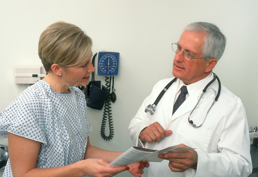 A doctor talks with his patient during an office visit in central Ohio (USA). Women's health.