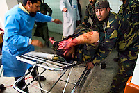 Baghdad, Iraq, April 5, 2003.Al Kindi hospital emergency ward: soldiers rush in a wounded comrade. More than 70 US bombardment victims were admitted in less than 2 hours after a B52 carpet bombing on the Northern outskirts, about a fifth of these were military personel.