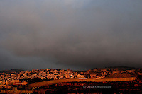 The separating wall surrounding Bethlehem and Aidah refuge camp at sunrise. Next week Pope Benedict XVI will visit Bethlehem and the refugee camp. Photo by Quique Kierszenbaum