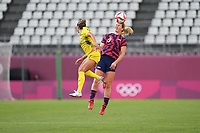 KASHIMA, JAPAN - AUGUST 5: Lindsey Horan #9 of the United States goes up for a header during a game between Australia and USWNT at Kashima Soccer Stadium on August 5, 2021 in Kashima, Japan.