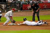 Houston Astros pitcher infielder Matt Downs #16 slides headfirst into third base during the Major League Baseball game against the Philadelphia Phillies at Minute Maid Park in Houston, Texas on September 13, 2011. Houston defeated Philadelphia 5-2.  (Andrew Woolley/Four Seam Images)