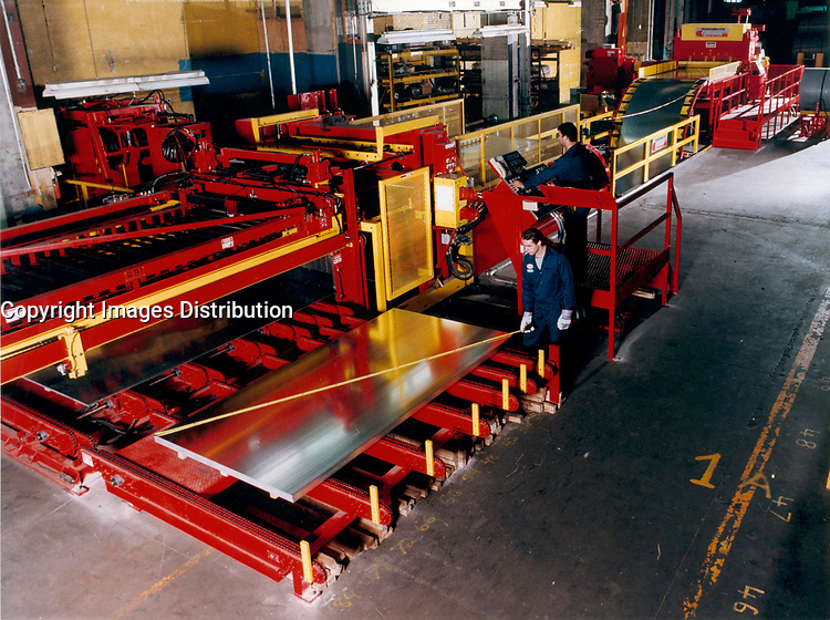 August 30, 1998, Laval, Quebec, Canada<br /> <br /> Employees check the size of a steel sheet after it is beeing cut from a steel roll, at Alliance Steel plant in Laval, Canada.  In a model & property released photo.<br /> <br /> THe European Union , the World Commerce Organisation as well as many countries  reacted stronly today, March 5th 2002 after the annonce by US Preseident Bush of a 30 % tax on steel importation into the US, to protect it's steel industry.<br /> only Canada, Mexico and 2 other countries are exempt from this tax<br /> <br /> Mandatory Credit: Photo by Pierre Roussel- Images Distribution. (©) Copyright by Pierre Roussel <br /> <br /> NOTE: scan from an 8x10 print of a 2 1/4 negative ,saved in Adobe 1998 RGB.<br /> <br /> NOTE : cannot be used by any steel industry competitor, doing steel roll to sheet tranformation.