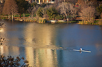 It's a beautiful winter day as a Rower in a scully crosses Lady Bird Lake in Austin, TX