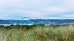 Yaquina Bay Bridge seen from South Beach, U.S. Highway 101, Pacific Coast Scenic Byway, near Newport, Oregon.  Oregon Central Coast, beaches, bays, bars, family fun, winter storms, lighthouses, fishing boats, bluffs, fossils and beach walks.
