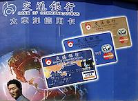 QS040505Shanghai003 20040505 SHANGHAI, CHINA:A man walks past a advertisement for credit cards in Shanghai, China.