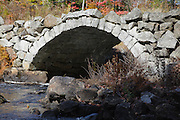 Stone arch bridge in Stoddard, New Hampshire USA during the autumn months