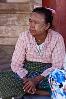 Myanmar, Burma.   Woman Wearing Thanaka Paste as a Cosmetic Sunscreen on Face.  Shwezigon (Shwezegon)  Pagoda, Nyaung Oo, near Bagan.