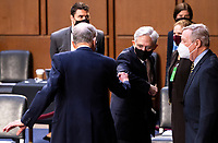 Merrick Garland, center, nominee to be United States Attorney General, speaks with ranking member US Senator Chuck Grassley (Republican of Iowa), Ranking Member, US Senate Committee on the Judiciary, and US Senator Dick Durbin (Democrat of Illinois), Chairman, US Senate Committee on the Judiciary, as he arrives for his confirmation hearing in the US Senate Judiciary Committee on Monday, Feb. 22, 2021. <br /> Credit: Bill Clark / Pool via CNP /MediaPunch