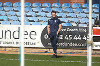 3rd April 2021; Dens Park, Dundee, Scotland; Scottish FA Cup Football, Dundee FC versus St Johnstone; Danny Mullen of Dundee inspects the pitch before the match