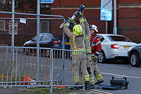 Pictured: Fire service personnel cut through the protective fence. Sunday 08 September 2019<br /> Re: Fire service and police attend a fire at the Palace Theatre, a dilapidated building in the High Street of Swansea, Wales, UK.