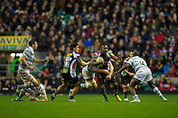 Ugo Monye of Harlequins in action as he is tackled by Topsy Ojo of London Irish (right) during the Aviva Premiership match between Harlequins and London Irish at Twickenham on Saturday 29th December 2012 (Photo by Rob Munro).