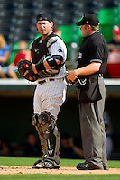Charlotte Knights catcher Bryan Anderson (33) chats with home plate umpire Clint Fagan between batters during the International League game against the Durham Bulls at Knights Stadium on August 18, 2013 in Fort Mill, South Carolina.  The Bulls defeated the Knights 5-1 in Game Two of a double-header.  (Brian Westerholt/Four Seam Images)