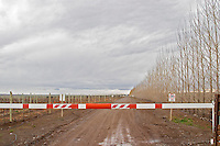 The entrance to the winery with boom blocking the road Bodega Del Fin Del Mundo - The End of the World - Neuquen, Patagonia, Argentina, South America
