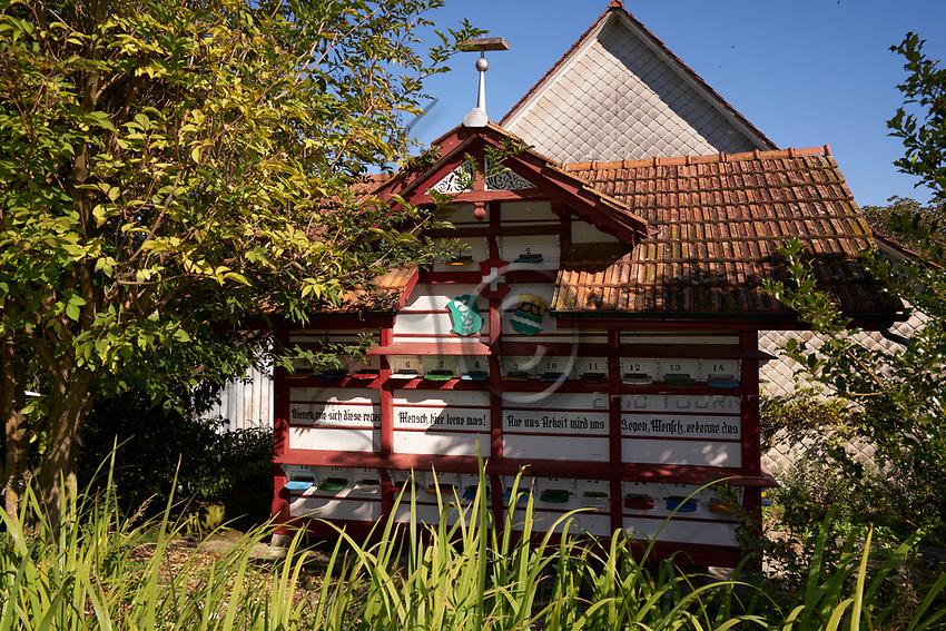 """A traditional chalet apiary at the Bregensdorf farm. First cited in 1315, the farm has housed basket hives for centuries. Beekeeping is a complementary activity for the Fisch family.<br /> """"Take the example of the hardworking bees, it is only through work that benediction comes"""".<br /> Un rucher châlet traditionnel à la ferme de Bregensdorf. Mentionée pour la première fois en 1315, la ferme a abrité des ruches panniers pendant des siècles. L'apiculture est un complément pour la famille Fisch.<br /> « Prends l'exemple des abeilles laborieuses, c´est seulement par le travail que vient la bénédiction »."""