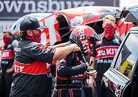 Jul 18, 2020; Clermont, Indiana, USA; NHRA funny car driver Alexis DeJoria is assisted with safety equipment by a crew member during qualifying for the Summernationals at Lucas Oil Raceway. Mandatory Credit: Mark J. Rebilas-USA TODAY Sports