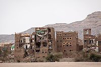 "Wednesday 15 July, 2015: Residential house buildings partially destroyed by heavy fighting are seen in the outskirts of Sa'dah, a city subdued to heavy bombardments carried out by the Arab states and their western allies led by Saudi Arabia in the northern province of Sa'dah, the stronghold of the Houthi's movement declared unilaterally ""a military zone"". The historic city of Sa'dah is among the places submitted on a tentative list to be under protection of UNESCO as a World Heritage site like the others enlisted cultural heritage sites in Yemen, such as the historic town of Zabid, the Old City of Sana'a and the Old Walled City of Shibam endangered by the ongoing aerial campaign of bombardments. (Photo/Narciso Contreras)"