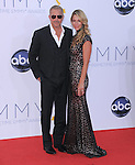 Kevin Costner, Christine Baumgartner at The 64th Anual Primetime Emmy Awards held at Nokia Theatre L.A. Live in Los Angeles, California on September  23,2012                                                                   Copyright 2012 Hollywood Press Agency