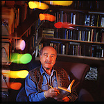 Former big band leader Artie Shaw, now retired, reads in his Southern California home library with his multichrome mobile by another famous artist, Alexander Calder, flowing in the breeze. Copyright JimMendenhallPhotos.com 2015