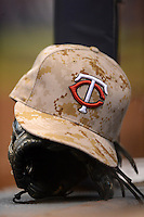 Minnesota Twins camouflage hat on the dugout step during a game against the Milwaukee Brewers at Miller Park on May 27, 2013 in Milwaukee, Wisconsin.  Minnesota defeated Milwaukee 6-3.  (Mike Janes/Four Seam Images)