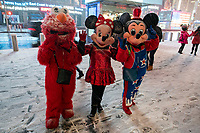NEW YORK, NEW YORK - JANUARY 31: People wearing customes of cartoons walk around Times Square during the pass of the snowstorm on January 31, 2021 in New York City. New York City Mayor Bill de Blasio declared a state of emergency order due to the arriving storm that's expected to wallop New York, where airports are expected to cancel the majority if their flights. (Photo by Eduardo MunozAlvarez/VIEWpress)