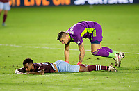 CARSON, CA - SEPTEMBER 19: Kellyn Acosta #10 of the Colorado Rapids fly's over David Bingham #1 GK of the Los Angeles Galaxy during a game between Colorado Rapids and Los Angeles Galaxy at Dignity Heath Sports Park on September 19, 2020 in Carson, California.