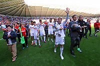 FAO SPORTS PICTURE DESK<br /> Pictured: Angel Rangel and team mate Andrea Orlandi botyh holding their babies thanking supporters at the end of the game. Sunday, 13 May 2012<br /> Re: Premier League football, Swansea City FC v Liverpool FC at the Liberty Stadium, south Wales.